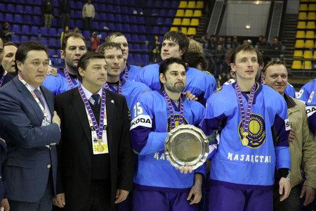 div: KYIV, UKRAINE - APRIL 23, 2011: Kazakhstan team - the winner of IIHF Ice-hockey World Championship DIV I Group B pose for a group photo on April 20, 2011 in Kyiv, Ukraine