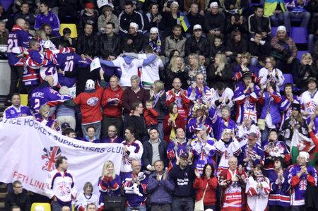 KYIV, UKRAINE - April 17, 2011: Britain fans celebrate during IIHF Ice-hockey World Championship DIV I Group B game against Ukraine on April 17, 2011 in Kyiv, Ukraine Stock Photo - 9475174