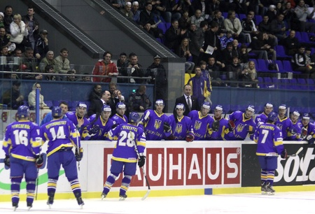 div: KYIV, UKRAINE - April 18, 2011: Ukraine players react after they scored against Lithuania during their IIHF Ice-hockey World Championship DIV I Group B game on April 18, 2011 in Kyiv, Ukraine