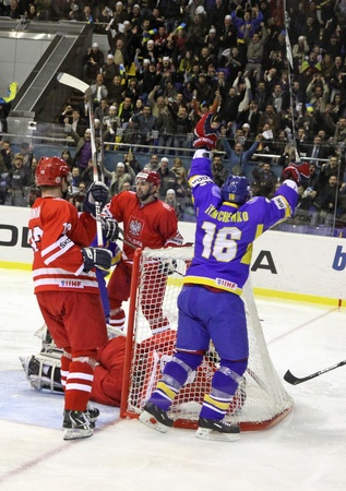KYIV, UKRAINE - APRIL 20, 2011: Oleg Tymchenko of Ukraine (in Blue) reacts after scores against Poland during their IIHF Ice-hockey World Championship DIV I Group B game on April 20, 2011 in Kyiv, Ukraine