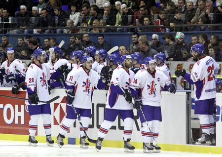 react: KYIV, UKRAINE - April 17, 2011: Great Britain team react after they scored against Ukraine during their IIHF Ice-hockey World Championship DIV I Group B game on April 17, 2011 in Kyiv, Ukraine