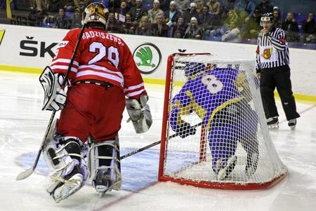 i net: KYIV, UKRAINE - APRIL 20, 2011: Andriy Mikhnov of Ukraine (in Blue) skates into the net during IIHF Ice-hockey World Championship DIV I Group B game against Poland on April 20, 2011 in Kyiv, Ukraine