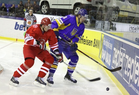 div: KYIV, UKRAINE - APRIL 20, 2011: Andriy Mikhnov of Ukraine (R) fights for a puck with Grzegorz Pasiut of Poland during their IIHF Ice-hockey World Championship DIV I Group B game on April 20, 2011 in Kyiv, Ukraine Editorial