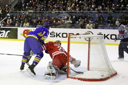 KYIV, UKRAINE - APRIL 20, 2011: Andriy Mikhnov of Ukraine (L) scores against Poland during their IIHF Ice-hockey World Championship DIV I Group B game on April 20, 2011 in Kyiv, Ukraine Stock Photo - 9638378