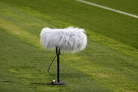 commentator: Microphone boom at a football stadium