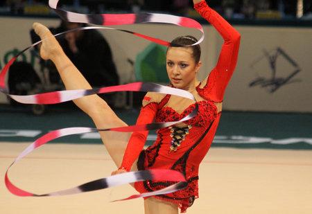 KYIV, UKRAINE - MAY 8, 2011: Silviya Miteva of Bulgaria performs during Deriugina Cup (Rhythmic Gymnastics World Cup) on May 8, 2011 in Kyiv, Ukraine Stock Photo - 9730367