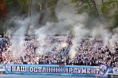 ultras: KYIV, UKRAINE - MAY 1, 2011: Dynamo Kyiv ultras perform during Ukraine Championship game against Arsenal on May 1, 2011 in Kyiv, Ukraine