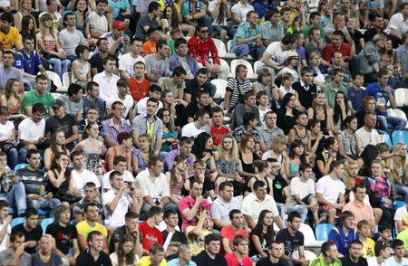 KYIV, UKRAINE - JUNE 1, 2011: People watch the Friendly football game between Ukraine and Uzbekistan national teams on June 1, 2011 in Kyiv, Ukraine