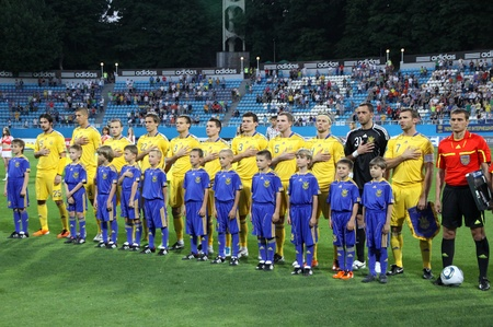 hymn: KYIV, UKRAINE - JUNE 1, 2011: Ukraine National football team players sing the hymn before Friendly game against Uzbekistan on June 1, 2011 in Kyiv, Ukraine