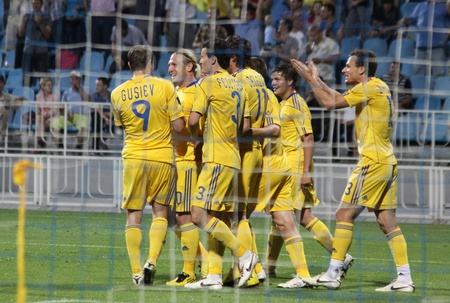 KYIV, UKRAINE - JUNE 1, 2011: Ukraine National Football team celebrate after scored against Uzbekistan during during their Friendly game on June 1, 2011 in Kyiv, Ukraine Stock Photo - 9889508