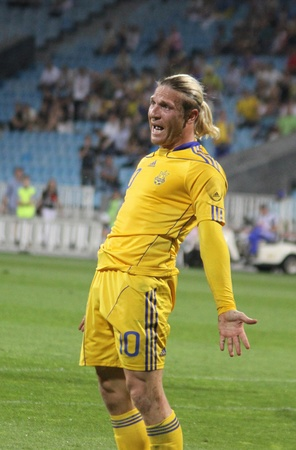 reacts: KYIV, UKRAINE - JUNE 1, 2011: Andriy Voronin of Ukraine reacts after missed a goal against Uzbekistan during their Friendly game on June 1, 2011 in Kyiv, Ukraine