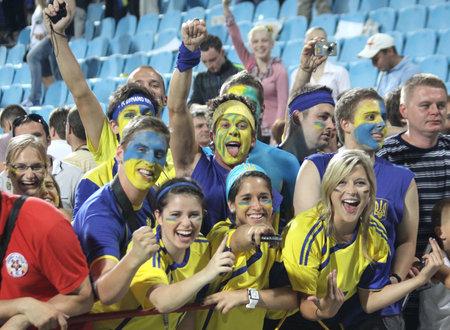 kyiv: KYIV, UKRAINE - JUNE 1, 2011: Ukrainian soccer fans react after Ukraine beat of Uzbekistan in their Frienfly game on June 1, 2011 in Kyiv, Ukraine