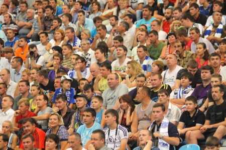 KYIV, UKRAINE - JULY 22, 2011: People watch the football game of Ukraine Championship between FC Dynamo Kyiv and FC Obolon on July 22, 2011 in Kyiv, Ukraine