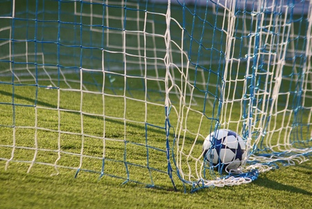 KYIV, UKRAINE - April 23, 2011: Soccer ball inside the net after Dynamo Kyiv scores against Arsenal during their Ukraine Championship game on April 23, 2011 in Kyiv, Ukraine 報道画像