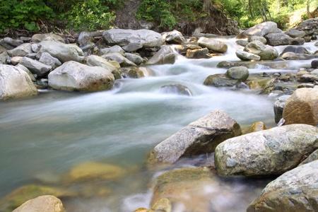 Beautiful cascade in Carpathian forest, Ukraine. Long exposure Stockfoto