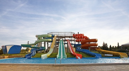 Colourful aquapark slides and swimming-pool photo
