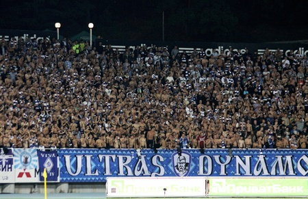 KYIV, UKRAINE - September 15, 2011: FC Dynamo Kyiv ultra supporters show their support during UEFA Europa League game against FC Stoke City on September 15, 2011 in Kyiv, Ukraine