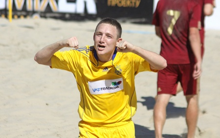 reacts: KYIV, UKRAINE - May 28, 2011: Oleksandr KORNIICHUK of Ukraine reacts after he scores against Russia during their friendly beach soccer game on May 28, 2011 in Kyiv, Ukraine