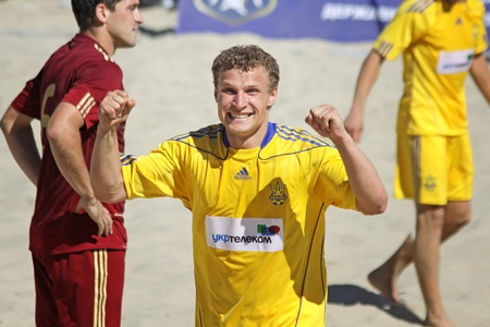 reacts: KYIV, UKRAINE - May 28, 2011: Igor BORSUK of Ukraine reacts after he scores against Russia during their friendly beach soccer game on May 28, 2011 in Kyiv, Ukraine