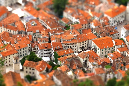 tilting: Bird eye view of buildings in Kotor old town, Montenegro. Tilt-shift Miniature Effect