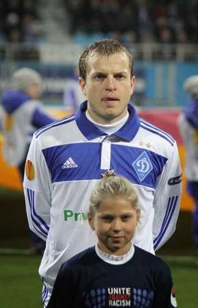gusev: KYIV, UKRAINE - OCTOBER 20, 2011: Oleh Gusev of Dynamo Kyiv and unidentified young children looks on during UEFA Europa League game against Besiktas on October 20, 2011 in Kyiv, Ukraine Editorial