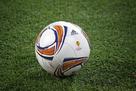KYIV, UKRAINE - OCTOBER 20, 2011: Close-up official UEFA Europa League 201112 season ball on the grass during the game between Dynamo and Besiktas on October 20, 2011 in Kyiv, Ukraine