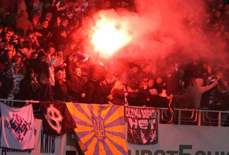 KYIV, UKRAINE - OCTOBER 26, 2011: FC Dynamo Kyiv ultras (ultra supporters) burn flares during Ukraine Championship game against Shakhtar Donetsk on October 26, 2011 in Kyiv, Ukraine