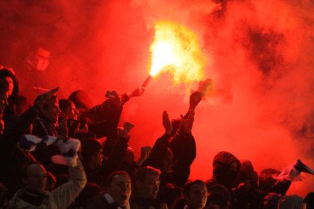 ultras: KYIV, UKRAINE - OCTOBER 26, 2011: FC Dynamo Kyiv ultras (ultra supporters) burn flares during Ukraine Championship game against Shakhtar Donetsk on October 26, 2011 in Kyiv, Ukraine Editorial