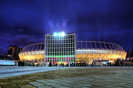 olimpiysky: KYIV, UKRAINE - OCTOBER 8, 2011: Visitors enter the Olympic stadium (NSC Olimpiyskyi) in Kyiv, Ukraine. The main stadium of Euro-2012 football championship