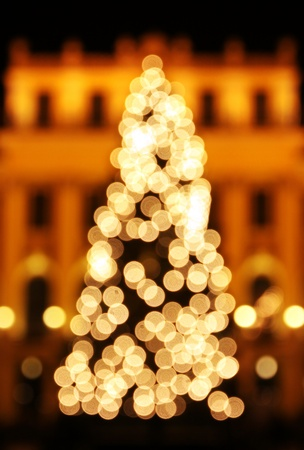 New Year tree made from golden bokeh lights photo