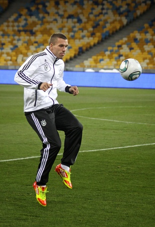 KYIV, UKRAINE - NOVEMBER 10, 2011: Lukas Podolski of Germany controls a ball during training session before friendly game against Ukraine at NSK Olimpic stadium on November 10, 2011 in Kyiv, Ukraine