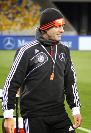 KYIV, UKRAINE - NOVEMBER 10, 2011: National coach Joachim Low of Germany smiles during training session before friendly game against Ukraine at NSK Olimpic stadium on November 10, 2011 in Kyiv, Ukraine Stock Photo - 11441040