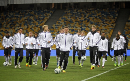 KYIV, UKRAINE - NOVEMBER 10, 2011: German national football team players run during training session at NSK Olimpic stadium on November 10, 2011 in Kyiv, Ukraine