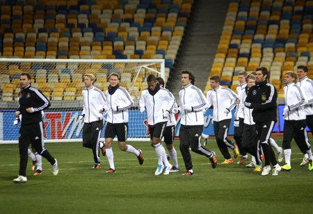 KYIV, UKRAINE - NOVEMBER 10, 2011: German national football team players run during training session at NSK Olimpic stadium on November 10, 2011 in Kyiv, Ukraine