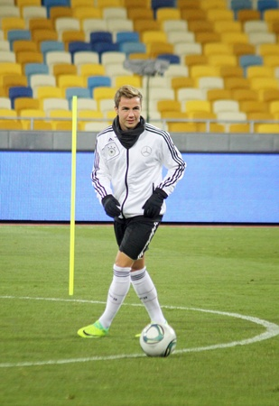 KYIV, UKRAINE - NOVEMBER 10, 2011: Mario Gotze of Germany controls a ball during training session before friendly game against Ukraine at NSK Olimpic stadium on November 10, 2011 in Kyiv, Ukraine