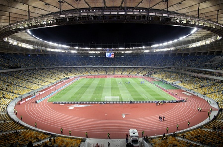 KYIV, UKRAINE - NOVEMBER 11, 2011: Panoramic view of Olympic stadium (NSC Olimpiysky) during friendly football game between Ukraine and Germany on November 11, 2011 in Kyiv, Ukraine. There is 1st game on this stadium after reconstruction Stock Photo - 12142385