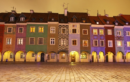 Night view of colourful houses in Old Market Square in Poznan, Poland photo
