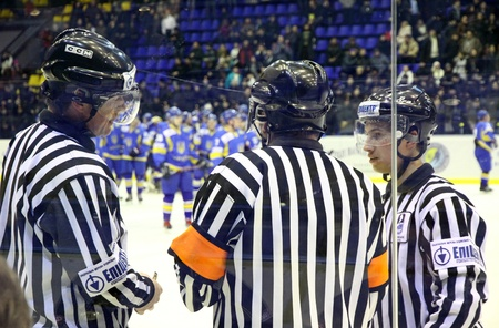 KYIV, UKRAINE - FEBRUARY 09, 2012: Ice-hockey referees in action during Euro Hockey Challenge game between Ukraine and Romania on February 09, 2012 in Kyiv, Ukraine Stock Photo - 12559330