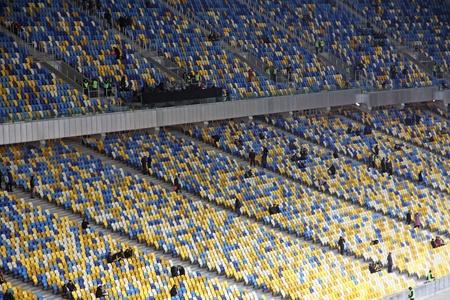 KYIV, UKRAINE - NOVEMBER 11, 2011: People fill the tribunes at the Olympic stadium (NSC Olimpiysky) before friendly football game between Ukraine and Germany on November 11, 2011 in Kyiv, Ukraine Stock Photo - 12559335