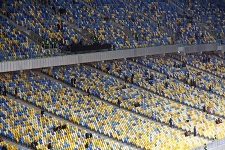olimpiysky: KYIV, UKRAINE - NOVEMBER 11, 2011: People fill the tribunes at the Olympic stadium (NSC Olimpiysky) before friendly football game between Ukraine and Germany on November 11, 2011 in Kyiv, Ukraine Editorial