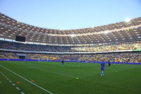 KYIV, UKRAINE - MARCH 18, 2012: Players run during training session before Ukraine Championship game between FC Dynamo Kyiv and FC Dnipro at NSC Olimpiyskiy stadium on March 18, 2012 in Kyiv, Ukraine