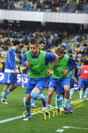 KYIV, UKRAINE - MARCH 18, 2012: FC Dnipro players runs during training session before Ukraine Championship game against FC Dynamo Kyiv at NSC Olimpiyskiy stadium on March 18, 2012 in Kyiv, Ukraine
