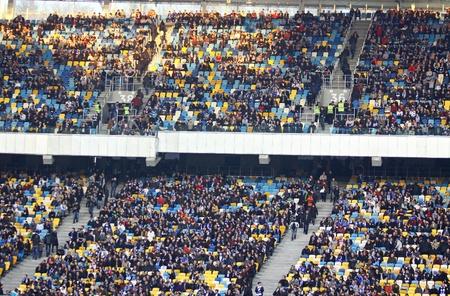 olimpiyskiy: KYIV, UKRAINE - MARCH 18, 2012: People watch the football game of Ukraine Championship between FC Dynamo Kyiv and FC Dnipro at NSC Olimpiyskiy stadium on March 18, 2012 in Kyiv, Ukraine