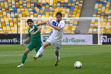 KYIV, UKRAINE - APRIL 14, 2012: Artem Milevskyi of Dynamo Kyiv (R) fights for a ball with Oleh Krasnopyorov of Vorskla Poltava during their Ukraine Championship game on April 14, 2012 in Kyiv, Ukraine Stock Photo - 13685610