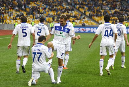 scored: KYIV, UKRAINE - APRIL 14, 2012: FC Dynamo Kyiv players celebrate after scored a goal against Vorskla Poltava during their Ukraine Championship game on April 14, 2012 in Kyiv, Ukraine
