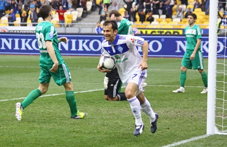 reacts: KYIV, UKRAINE - APRIL 14, 2012: Carlos Correa of Dynamo Kyiv (R) reacts after he scored a goal during during Ukraine Championship game against Vorskla Poltava on April 14, 2012 in Kyiv, Ukraine
