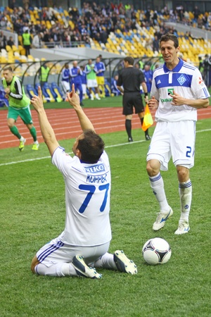scored: KYIV, UKRAINE - APRIL 14, 2012: FC Dynamo Kyiv players celebrate after scored a goal against Vorskla Poltava during their Ukraine Championship game on April 14, 2012 in Kyiv, Ukraine