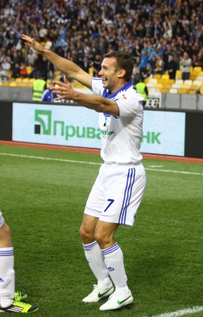 scored: KYIV, UKRAINE - APRIL 14, 2012: Andriy Shevchenko of Dynamo Kyiv (R) reacts after he scored a goal during Ukraine Championship game against Vorskla Poltava on April 14, 2012 in Kyiv, Ukraine