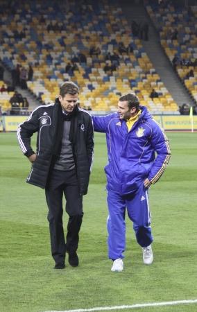 KYIV, UKRAINE - NOVEMBER 11, 2011: Ukrainian forward Andriy Shevchenko (R) speaks with German Manager Oliver Bierhoff (both - former AC Milan players) during their friendly game on November 11, 2011 in Kyiv, Ukraine