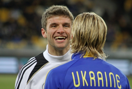 KYIV, UKRAINE - NOVEMBER 11, 2011: German forward Thomas M�ller (L) speaks with Ukrainian defender Anatoliy Tymoshchuk (both - Bayern Munich players) during their friendly game on November 11, 2011 in Kyiv, Ukraine